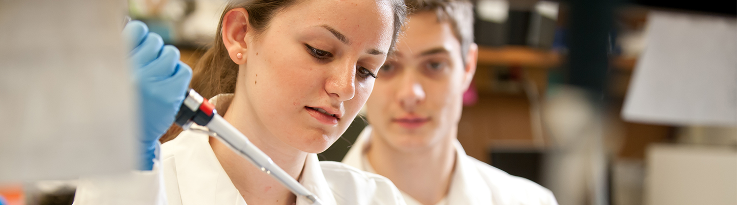 Two young students in a laboratory